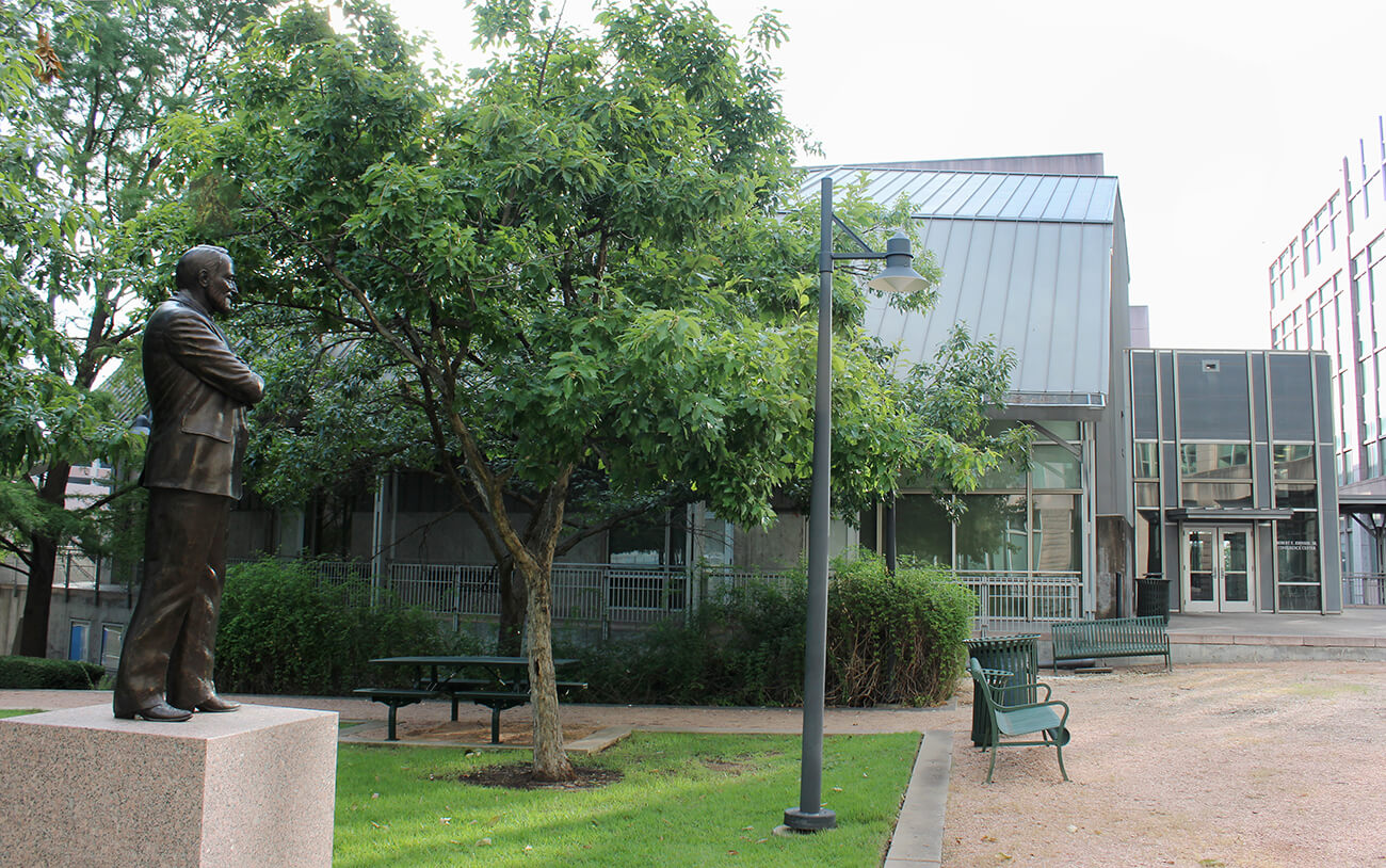 Picture of the courtyard with REJ building in background